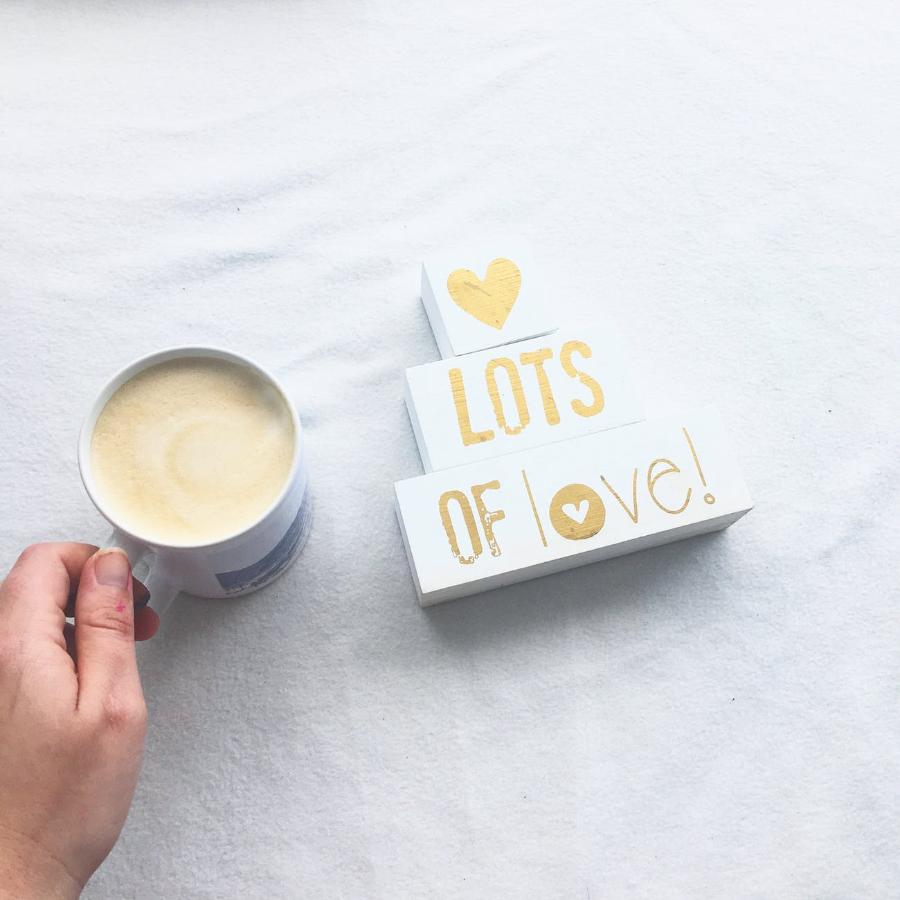 person holding white ceramic coffee mug